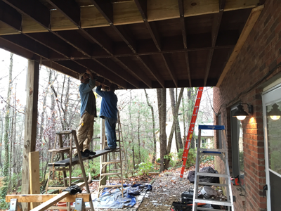 Cleaning the joists in preparation for the corrugated soffit