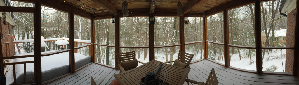 A cold and snowy pano shot of the porch. The need for wider overhangs is evident.